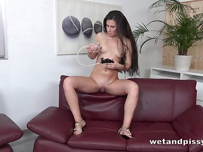Young brunette empties her bladder and plays with it