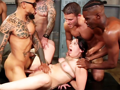 Bound brunette enjoys her very first interracial gang-bang