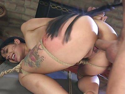 Quite bootyful brunette Gina Valentina deserves some really hard doggy banging