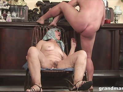 Most assuredly old amateur with glasses spreads her legs to be fucked by a stud